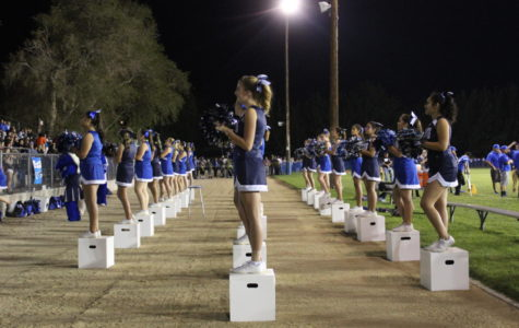 The Bishop cheer team leads the energized crowd in a spirited cheer