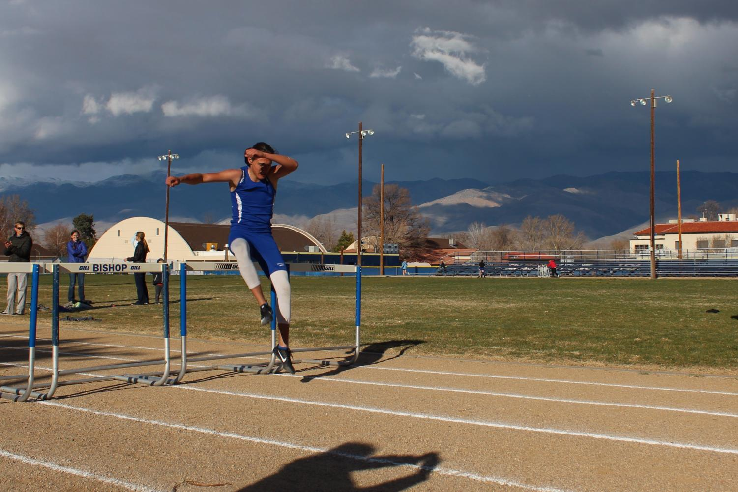 Jon Tait, a junior, completes the boys' 300 meter hurdles, marking the beginning of his hurdling career