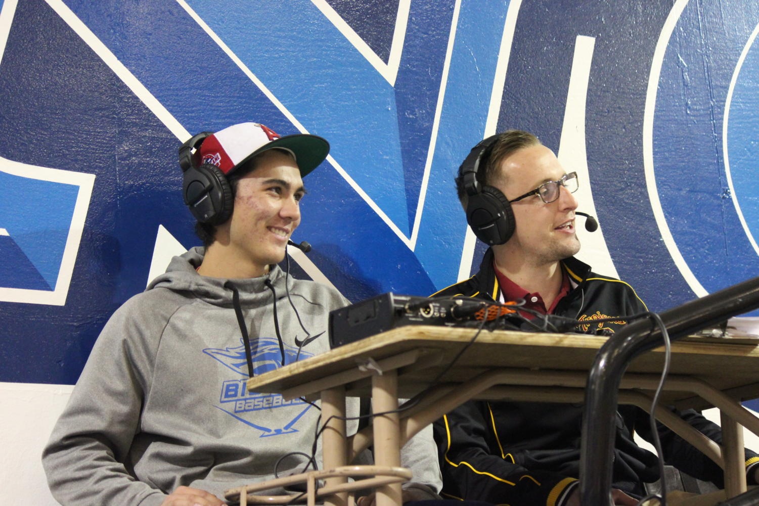 Matthew Rosga with Bronco Round up doing a broadcast on Boys basketball game with Bradford Evans from KIBS