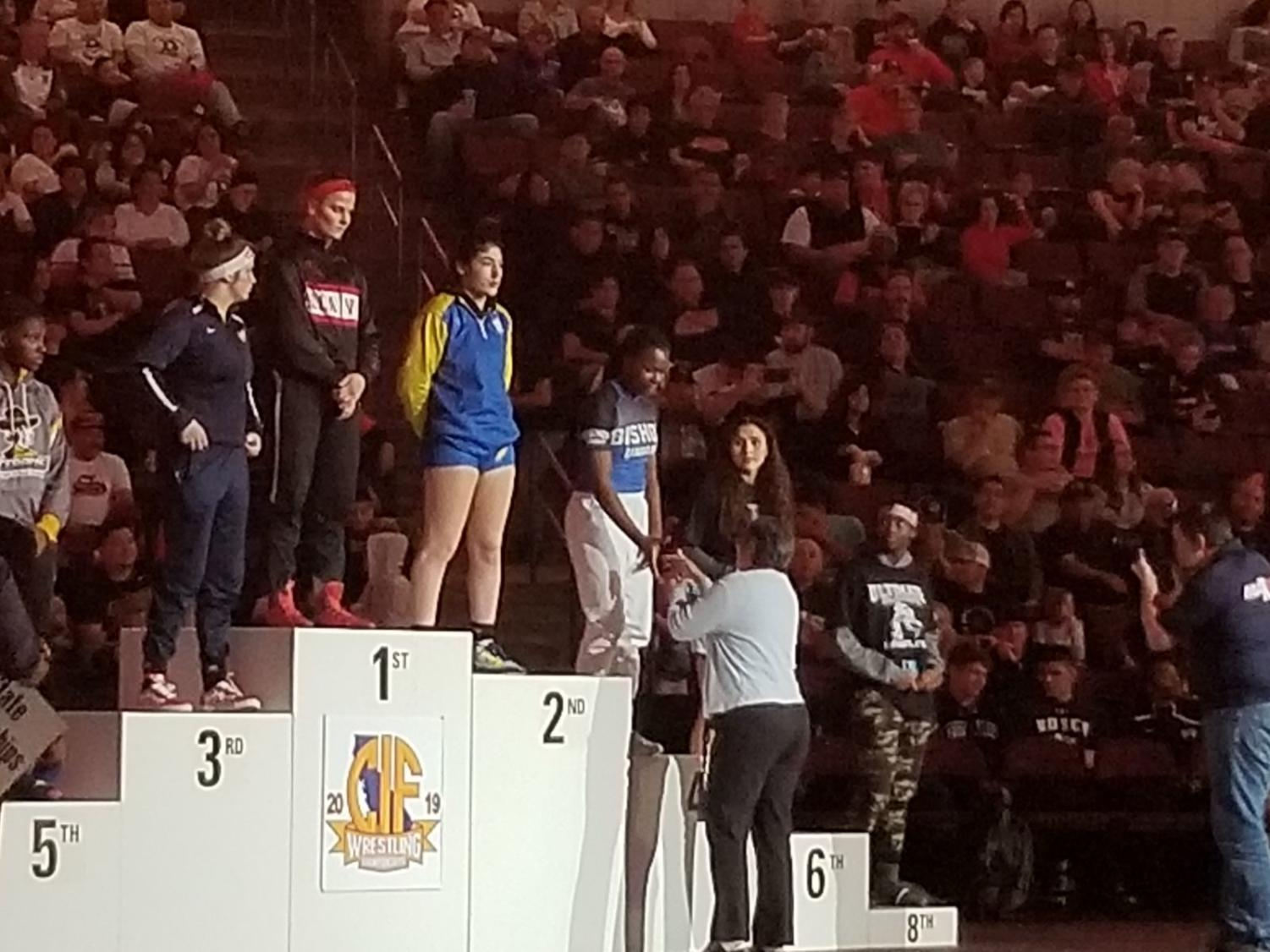 Tia receiving her 4th place medal.  Photo provided by Celia Mayhugh