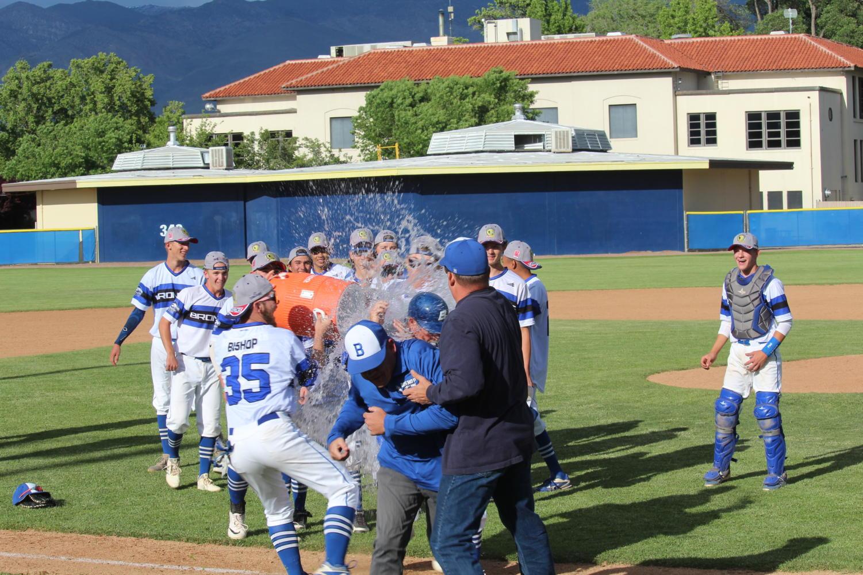 Coach having water thrown at him.