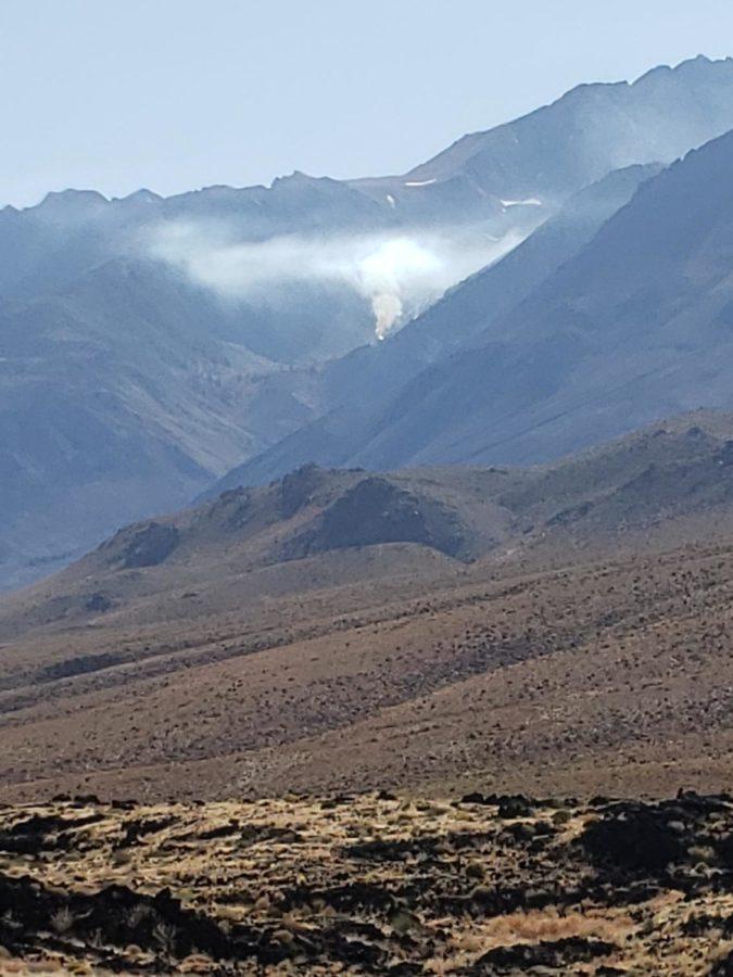 smoke behind mountain